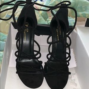 Black heels that wrap around your legs